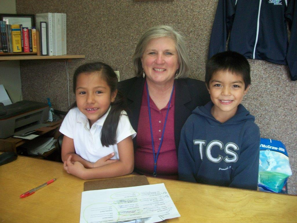 TCS Principle Mrs. Diane Lyles with 2 TCS students